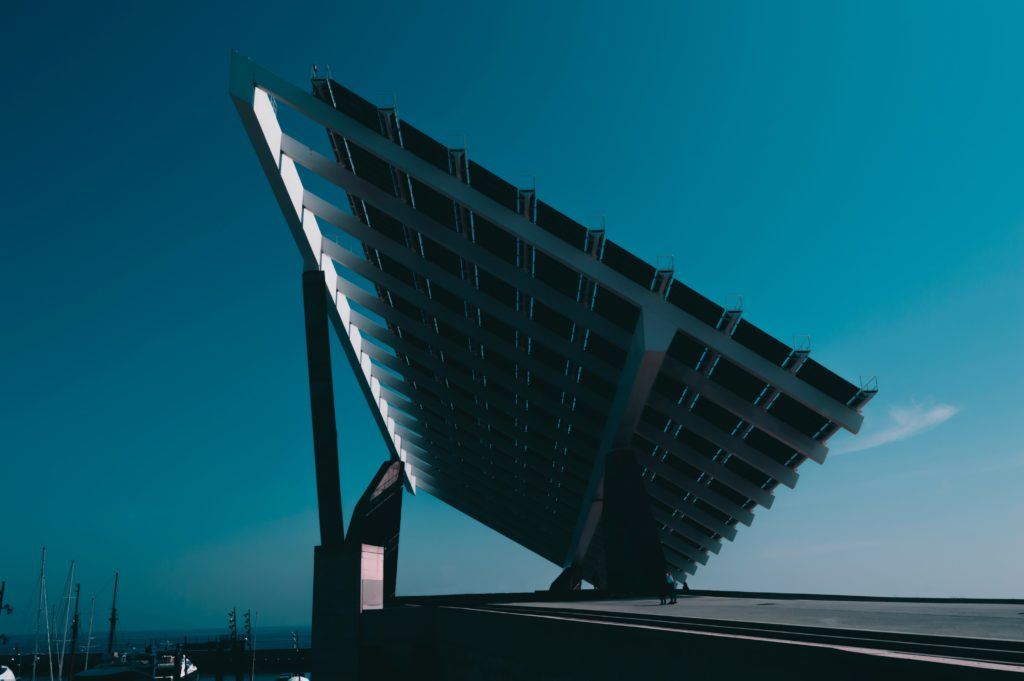 behind solar panels